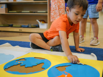 kid assembling word map at our daycare in cypress
