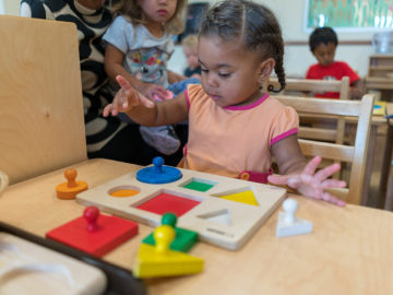 small kid learning block arrangements