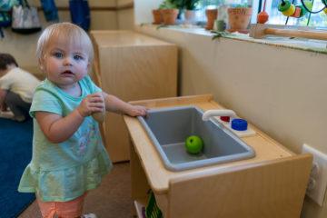 Child Washing Fruit