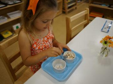 child having food at our montessori school