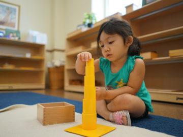girl kid playing block building game