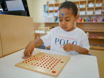 Kid learning abacus at our montessori school in cypress